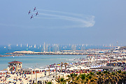 """Israeli Air Force (IAf) """"Efroni"""" (T-6 Texan II) formation performs an aerobatic maneuver during Independence Day celebrations in Tel-Aviv, Israel April 15, 2021. People gathered in their masses at Tel-Aviv's shore line as the Jewish state celebrates 73 years to it's establishment. As vast percentage of the population are vaccinated, celebrations were able to take place in a some what ordinary manner.Starting Sunday April 18, 2021, it will no longer be mandatory to wear a protective mask in open spaces throughout the country."""