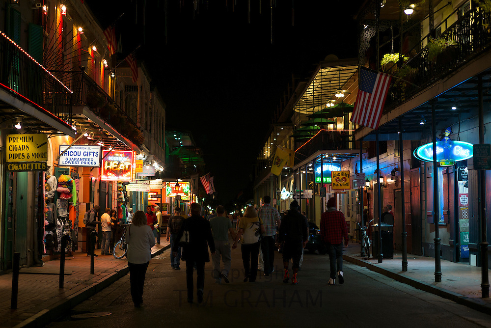 Crowds of revellers in famous Bourbon Street in French Quarter of New Orleans, USA