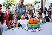 Noah Stout celebrates his 7th birthday with friends and family at his home in Milpitas, California, on September 15, 2013. (Stan Olszewski/SOSKIphoto)