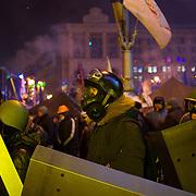January 24, 2014 - Kiev, Ukraine: A group of protestors prepare to take guard at the demonstrators barricades surrounding the Independence Square in Kiev. (Paulo Nunes dos Santos)