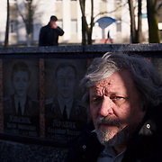 """Liquidator"" Alexander Demidov, 61, sits in front of a commemoration of the heroes that perished during the Chernobyl explosion in 1986. He was part of a massive team responsible for the clean up of the nuclear fallout in the months and years that followed. <br /> <br /> He is posing in the main town square of Slavutych, his home for the last decades. He is suffering from multiple health problems in his lungs and joints. <br /> <br /> Slavutych rises out of the ashes of the Chernobyl nuclear disaster in April 26, 1986. People living near the disaster area were largely moved to the new city, built from scratch for the sole purpose of housing the population displaced by the nuclear accident."