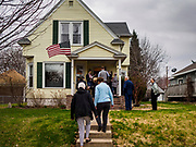 "17 APRIL 2019 - MARSHALLTOWN, IOWA: People walk into a home in Marshalltown, Iowa, for a meet and greet for Mayor Pete Buttigieg, the mayor of South Bend, Indiana. ""Mayor Pete,"" as he goes by, declared his candidacy to be the Democratic nominee for the US Presidency on April 14. Buttigieg is touring Iowa this week. Iowa traditionally hosts the the first selection event of the presidential election cycle. The Iowa Caucuses will be on Feb. 3, 2020.      PHOTO BY JACK KURTZ"