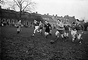Irish Rugby Football Union, Ireland v England, Five Nations, Irish team practice at College Park, Dublin, Ireland, Thursday 7th February, 1957,.7.2.1957, 2.7.1957,..Irish Team, ..P J Berkery, Wearing number 15 Irish jersey, Full back, Landsdowne Rugby Football Club, Dublin, Ireland,..A J O'Reilly, Wearing number 14 Irish jersey, Right wing, Old Belvedere Rugby Football Club, Dublin, Ireland,  ..N J Henderson, Wearing number 13 Irish jersey, Captain of the Irish team, Right centre, N.I.F.C, Rugby Football Club, Belfast, Northern Ireland, ..A C Pedlow, Wearing number 12 Irish jersey, Left centre, Queens University Rugby Football Club, Belfast, Northern Ireland,..N H Brophy, Wearing number 11 Irish jersey, Left wing, University College Dublin Rugby Football Club, Dublin, Ireland, ..J W Kyle, Wearing number 10 Irish jersey, Ouside Half, N.I.F.C, Rugby Football Club, Belfast, Northern Ireland, ..A A Mulligan, Wearing Number 9 Irish Jersey, Scrum half, London Irish Rugby Football Club, Surrey, England, and, Cambridge University Rugby Football Club, Cambridge, England, ..P J O'Donoghue, Wearing  Number 1 Irish jersey, Forward, Bective Rangers Rugby Football Club, Dublin, Ireland,..R Roe, Wearing number 2 Irish jersey, Forward, London Irish Rugby Football Club, Surrey, England, ..B G Wood, Wearing number 3 Irish jersey, Forward, Garryowen Rugby Football Club, Limerick, Ireland, ..T E Reid, Wearing number 4 Irish jersey, Forward, Garryowen Rugby Football Club, Limerick, Ireland, and, London Irish Rugby Football Club, Surrey, England, ..J R Brady, Wearing number 5 Irish jersey, Forward, C I Y M S Rugby Football Club, Belfast, Northern Ireland, ..H S O'Connor, Wearing number 6 Irish jersey, Forward, Dublin University Rugby Football Club, Dublin, Ireland,..P J A O'Sullivan, Wearing  Number 7 Irish jersey, Forward, Galwegians Rugby Football Club, Galway, Ireland,...J R Kavanagh, Wearing number 8 Irish jersey, Forward, Wanderers Rugby Football Club, Dublin, Ireland, ....