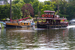 A paddle steamer makes its way towards Windsor on the River Thames at Old Windsor, Berkshire. Old Windsor, Berkshire, July 05 2019.