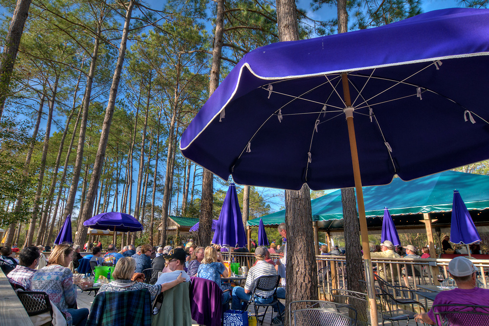 People enjoy the outdoor seating and live music at La Belle Amie Vineyard in Little River, SC on Wednesday, February 8, 2017. Copyright 2017 Jason Barnette