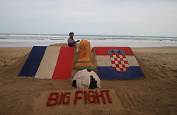 July 13, 2018 - Bhubaneswar, Odisha, India - On 13 July 2018, the Indian sand artist Manas Sahoo creates FIFA WOrld Cup 2018 final sand sculpture for visitors attraction at the Bay of Bengal Sea's eastern coast beach Puri, 65 km away from the eastern Indian state Odisha's capital city Bhubaneswar ahead of the final match between France and Croatia. (Credit Image: © Str/NurPhoto via ZUMA Press)