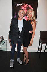 Photographer BRUNO BISANG and TAMARA BECKWITH at a Private View of Bruno Bisang 30 Years of Polaroids held at The Little Black Gallery, 13A Park Walk, London SW10 on 15th January 2013.