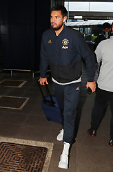Sergio Romero is spotted on his way to catch a flight as the team fly to Turin on Tuesday afternoon to play Juventus in The Champions League on Wednesday night.