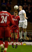 Photo. Jed Wee.<br /> Liverpool v Bolton Wanderers, FA Barclaycard Premiership, Anfield, Liverpool. 26/12/2003.<br /> Liverpool's John Arne Riise (L) and Bolton's Kevin Davies contest a header.