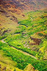 Meandering Waimea River and Waimea Canyon, the 'Grand Canyon of the Pacific Ocean', approximately one mile wide and ten miles long, more than 3,500 feet deep, State Park, Kauai, Hawaii