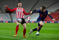 ootball - 2020 / 2021 Sky Bet League One - Sunderland vs Blackpool - Stadium of Light<br /> <br /> James Husband of Blackpool vies with Aiden O'Brien of Sunderland<br /> <br /> Credit: COLORSPORT/BRUCE WHITE