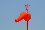 Orange Windsock on a blue sky background Photographed in an airfield in Haifa, Israel