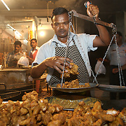 Rajinder Da Dhaba at Safdarjung enclave is a hot spot for meat lovers. the place is a buzz in the evenings and one could have his choice of a variety of famous delicacies like Tandoori Chicken or Kebab, Fried fish, chicken and more. You can have your food in a plate or rapped in a specialy made, thin and delicate Rumali Roti. New Delhi, May 2007