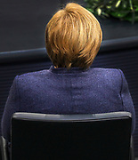 German Chancellor Angela Merkel listens as Secretary General of the United Nations, António Guterres (not pictured), delivers a speech at the lower house of the German Parliament, the Bundestag in Berlin, Germany, December 18, 2020. Guterres was invited as an honorary guest on the occasion of  the founding of the United Nations 75 years ago. <br /> (Photo by Omer Messinger)