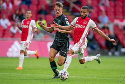 Zakaria Labyad of Ajax, Melle Meulensteen of RKC Waalwijk in action during eredivisie round 02 between Ajax and RKC at Johan Cruyff Arena on September 20, 2020 in Amsterdam, Netherlands