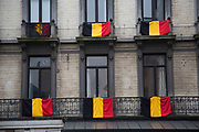 Belgian flags hanging from balconies in Brussels, Belgium. The Brussels-Capital Region is a region of Belgium comprising 19 municipalities, including the City of Brussels.