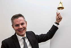 """Derek Mackay, Finance Secretary rings the """"Success Bell"""" at the official opening of the building services firm's office at Ratho, Edinburgh. The bell is rung to mark achievements by the company and its employees. Pic: Terry Murden @edinburghelitemedia"""