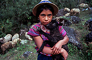 Shepherd girl holding black sheep, Todos Santos, Huehuetenango, Guatemala