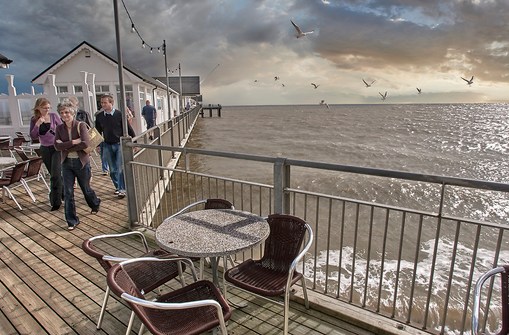 By The Sea  Southwold Suffolk photo art pictures of Southwold pier and touists in the winter taken in 2007 by Paul Williams .<br /> <br /> Visit our REPORTAGE & STREET PEOPLE PHOTO ART PRINT COLLECTIONS for more wall art photos to browse https://funkystock.photoshelter.com/gallery-collection/People-Photo-art-Prints-by-Photographer-Paul-Williams/C0000g1LA1LacMD8