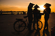 Women offer mobile manicure and pedicure services on the Mekong waterfront. They carry nail files, clippers, creams and lotions in their bicycle baskets, Mekong Waterfront, Vientiane, Laos