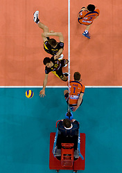Miguel Falasca (10) and Marcin Mozdzonek of Belchatow vs Andrej Flajs of ACH at  match for 3rd place of CEV Indesit Champions League FINAL FOUR tournament between PGE Skra Belchatow, POL and ACH Volley Bled, SLO on May 2, 2010, at Arena Atlas, Lodz, Poland. Belchatow defeated ACH 3-1. (Photo by Vid Ponikvar / Sportida)
