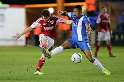Bristol City's Brendan Moloney in action with Peterborough United's Britt Assombalonga - Photo mandatory by-line: Joe Dent/JMP - Mobile: 07966 386802 11/03/2014 - SPORT - FOOTBALL - Peterborough - London Road Stadium - Peterborough United v Bristol City - Sky Bet League One