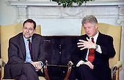 US President Bill Clinton comments during a meeting with NATO Secretary General Javier Solana (L) March 15, 1999 in the Oval Office at the White Hose in Washington, DC. During the meeting President Clinton said he is optimistic at the news that the Kosovaars are willing to sigh a peace agreement with the Serbs.