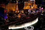 Illuminated fountains at Bellagio, with the Paris Las Vegas Hotel and Casino in background.