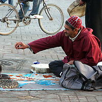 North Africa, Africa, Morocco, Marrakesh. A snake charmer in the Djeema el Fna square.