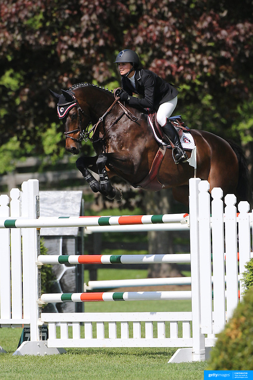 Georgina Bloomberg riding Caleno 3 in action during the $100,000 Empire State Grand Prix presented by the Kincade Group during the Old Salem Farm Spring Horse Show, North Salem, New York,  USA. 17th May 2015. Photo Tim Clayton