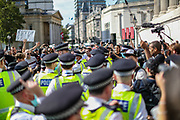 """People scuffle with police as thousands of protesters from across the UK gathered in London's Trafalgar Square on Saturday, Sept 19, 2020 - afternoon to protest against coronavirus restrictions and reject mass vaccinations. The event, which began at noon, drew a broad coalition including coronavirus sceptics, 5G conspiracy theorists and so-called """"anti-vaxxers"""". Speakers at the event accused the government of attempting to curtail civil liberties. (VXP Photo/ Vudi Xhymshiti)"""