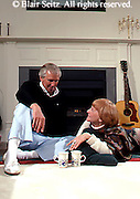 Active Aging Senior Citizens, Retired, Activities, Older Couple Relax at Fireplace with Music