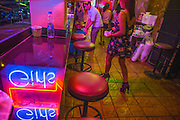 """18 JANUARY 2013 - BANGKOK, THAILAND: The entrance to DC10, a """"go-go bar"""" in the Nana Entertainment District in Bangkok. Prostitution in Thailand is technically illegal, although in practice it is tolerated and partly regulated. Prostitution is practiced openly throughout the country. The number of prostitutes is difficult to determine, estimates vary widely. Since the Vietnam War, Thailand has gained international notoriety among travelers from many countries as a sex tourism destination. One estimate published in 2003 placed the trade at US$ 4.3 billion per year or about three percent of the Thai economy. It has been suggested that at least 10% of tourist dollars may be spent on the sex trade. According to a 2001 report by the World Health Organisation: """"There are between 150,000 and 200,000 sex workers (in Thailand).""""          PHOTO BY JACK KURTZ"""