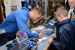 Bristol Rovers Lee Brown signs autographs for a fan at the club shop during an Open Day - Mandatory by-line: Dougie Allward/JMP - 07966386802 - 26/07/2015 - SPORT - FOOTBALL - Bristol,England - Memorial Stadium - Bristol Rovers Open Day - Bristol Rovers Open Day