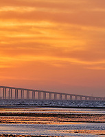 Sun rising under the Sunshine Skyway bridge from Fort De Soto Park. Print copy 5 of 5 images taken with a Fuji X-H1 camera and 200 mm f/2 OIS lens with a 1.4x teleconverter (ISO 400, 280 mm, f/16, 1/80 sec). Raw images processed with Capture One Pro and AutoPano Giga Pro.
