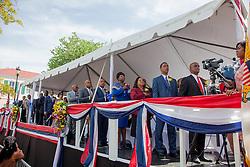 The Senators salute the Virgin Islands flag during the Virgin Islands March.  St. Thomas Swearing-In Ceremony for the 32nd Legislature of the US Virgin Islands.  Emancipation Garden.  St. Thomas, VI.  9 January 2017.  © Aisha-Zakiya Boyd