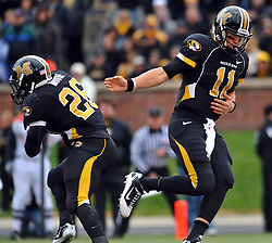 Nov 13, 2010; Columbia, MO, USA;  Missouri Tigers quarterback Blaine Gabbert (11) hands off to running back De'Vion Moore (26) in the first half against the Kansas State Wildcats at Memorial Stadium. Mandatory Credit: Denny Medley-US PRESSWIRE