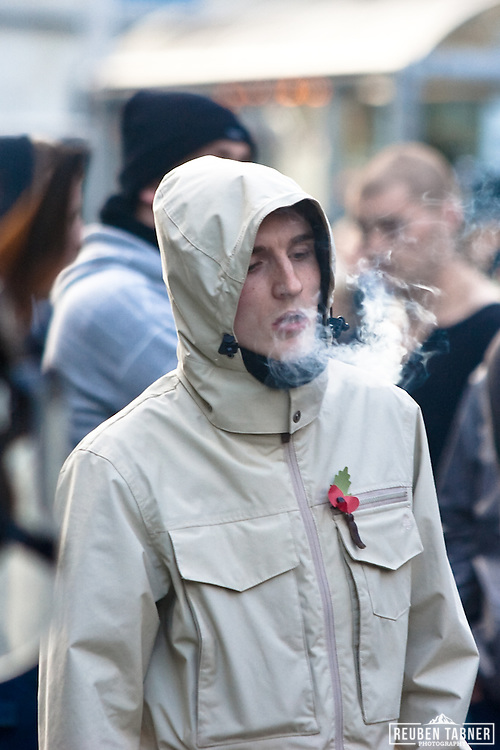 An EDL member waits for Police to lift the cordon.
