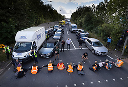© Licensed to London News Pictures. 29/09/2021. Swanley, UK. Traffic backs up and motorists look on as Insulate Britain activists block the road near to junction 3 of the M25 motorway near Swanley for the second time today. 11 members of the campaign group were detained at the same junction earlier today. This is the seventh time in just over two weeks that activists have disrupted traffic on London's orbital motorway despite the government being granted a temporary High Court Injucntion banning the group from protesting on the M25. 50 protesters who were detained after Monday's protest, on junction 14 of the M25 at Heathrow, were released. Photo credit: Peter Macdiarmid/LNP