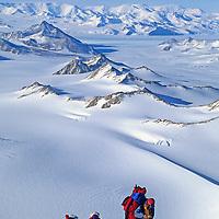 ANTARCTICA, Climber (MR) near summit of Mt. Vaughan.