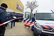 Nederland, Millingen, 4-12-2013Inval door politie in autosloperij Nijs aan het Molenveld. Politielint bij inval door justitie vanwege hennepplantage, wietplantage en handel in gestolen onderdelen voor autos.Foto: Flip Franssen