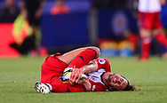 Grzegorz Krychowiak of West Bromwich Albion holds his foot  in pain after taking a knock.Premier league match, Leicester City v West Bromwich Albion at the King Power Stadium in Leicester, Leicestershire on Monday 16th October 2017.<br /> pic by Bradley Collyer, Andrew Orchard sports photography.
