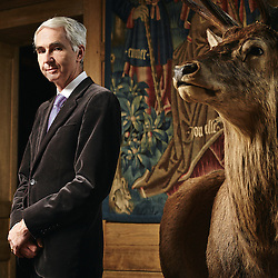 Paris, France. February 6, 2015. Claude d'Anthenaise, Chief Curator of the french Museum of Hunting and Nature, posing with a deer in his Museum. Photo: Antoine Doyen