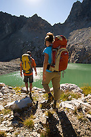 A young couple hikes above Timberline Lake in Grand Teton National Park, Jackson Hole, Wyoming.