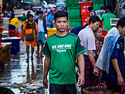 23 NOVEMBER 2017 - YANGON, MYANMAR: Laborers at the San Pya Fish Market. San Pya Fish Market is one of the largest fish markets in Yangon. It's a 24 hour market, but busiest early in the morning. Most of the fish in the market is wild caught but aquaculture is expanding in Myanmar and more farmed fresh water fish is being sold now than in the past.    PHOTO BY JACK KURTZ