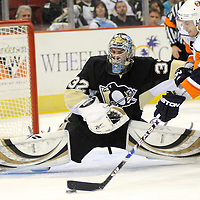 New York Islanders Jeff Tambellini takes a shot on Pittsburgh Penguins goalie Mathieu Garon during a five on three  power play in the second period at Mellon Arena in Pittsburgh on April 9, 2009.     (UPI Photo/Archie Carpenter)