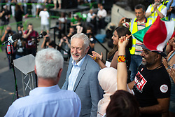 © Licensed to London News Pictures . 13/07/2018. London, UK. JEREMY CORBYN addresses thousands of demonstrators in Trafalgar Square at a rally in protest against US President Donald Trump's UK visit . Photo credit: Joel Goodman/LNP