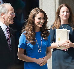 © Licensed to London News Pictures. 19/07/2012. London, UK. Catherine Duchess of Cambridge leaving the National Portrait Gallery on July 19, 2012 with Sandy Nairne, Director of the National Portrait Gallery after attending a viewing of an exhibition titled 'BT Road To 2012: Aiming High'.  Highlights of the exhibition include portraits of gymnast Beth Tweddle and sprinter Jodie Williams. The exhibition opens today (19/07/2012) and runs to September 23 as Part of the London 2012 Festival. Photo credit : Ben Cawthra/LNP