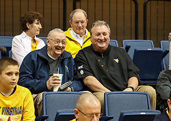 Jan 20, 2018; Morgantown, WV, USA; West Virginia Mountaineers head coach Bob Huggins talks with father Charlie Huggins before their game against the Texas Longhorns at WVU Coliseum. Mandatory Credit: Ben Queen-USA TODAY Sports