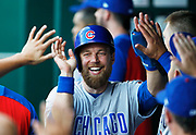 Chicago Cubs' Ben Zobrist reacts in the dugout after scoring off a David Bote triple in the first inning of a baseball game against the Kansas City Royals at Kauffman Stadium in Kansas City, Mo., Monday, Aug. 6, 2018. (AP Photo/Colin E. Braley)